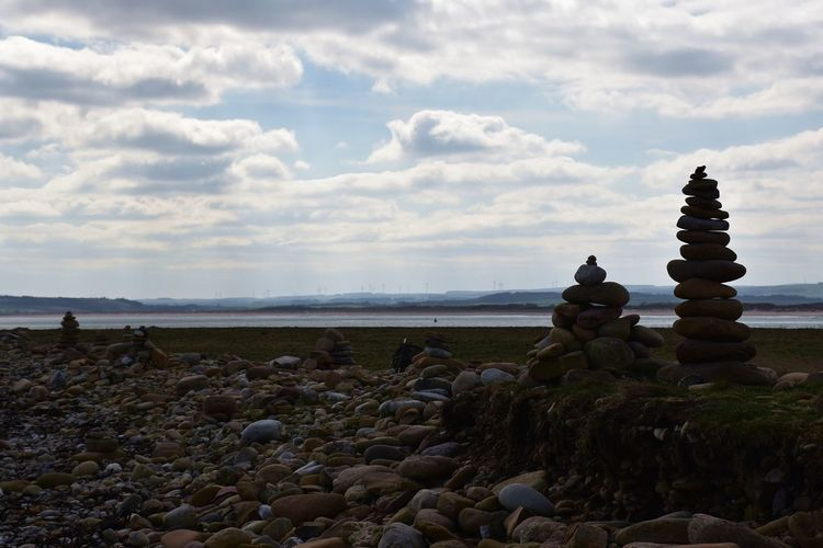 A view from a beach on Lindisfarne Cloud - Sky Rock Sky Solid Stack Pebble Balance Beach Rock - Object Land Stone - Object Scenics - Nature Tranquil Scene Tranquility Nature Water Stone Sea Zen-like No People Horizon Over Water Outdoors Clouds And Sky Pebble Beach Pebbles Cairn Balancing Pile Silhouette Day Seascape Backgrounds View Scenics
