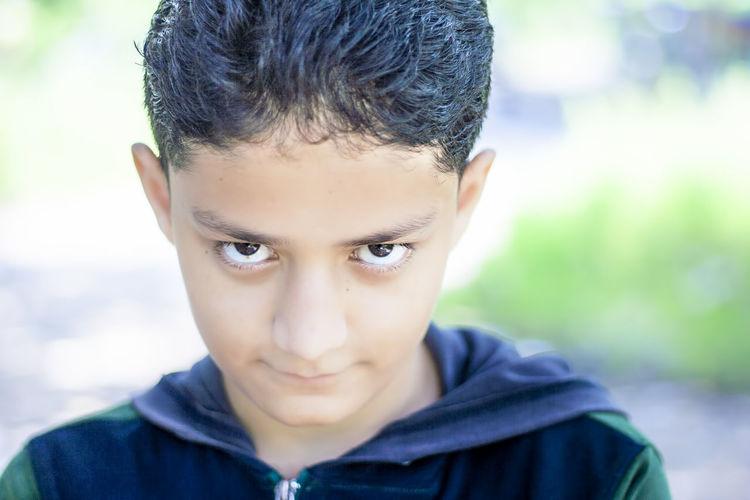 Close-up portrait of boy outdoors