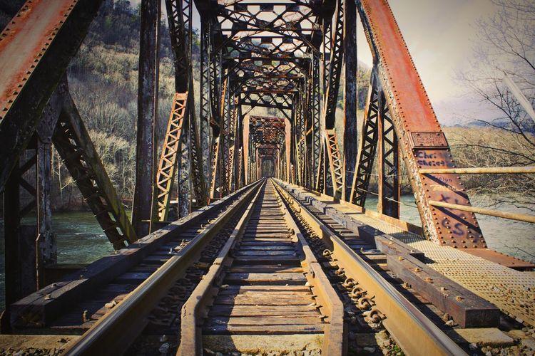 Old railway bridge against sky