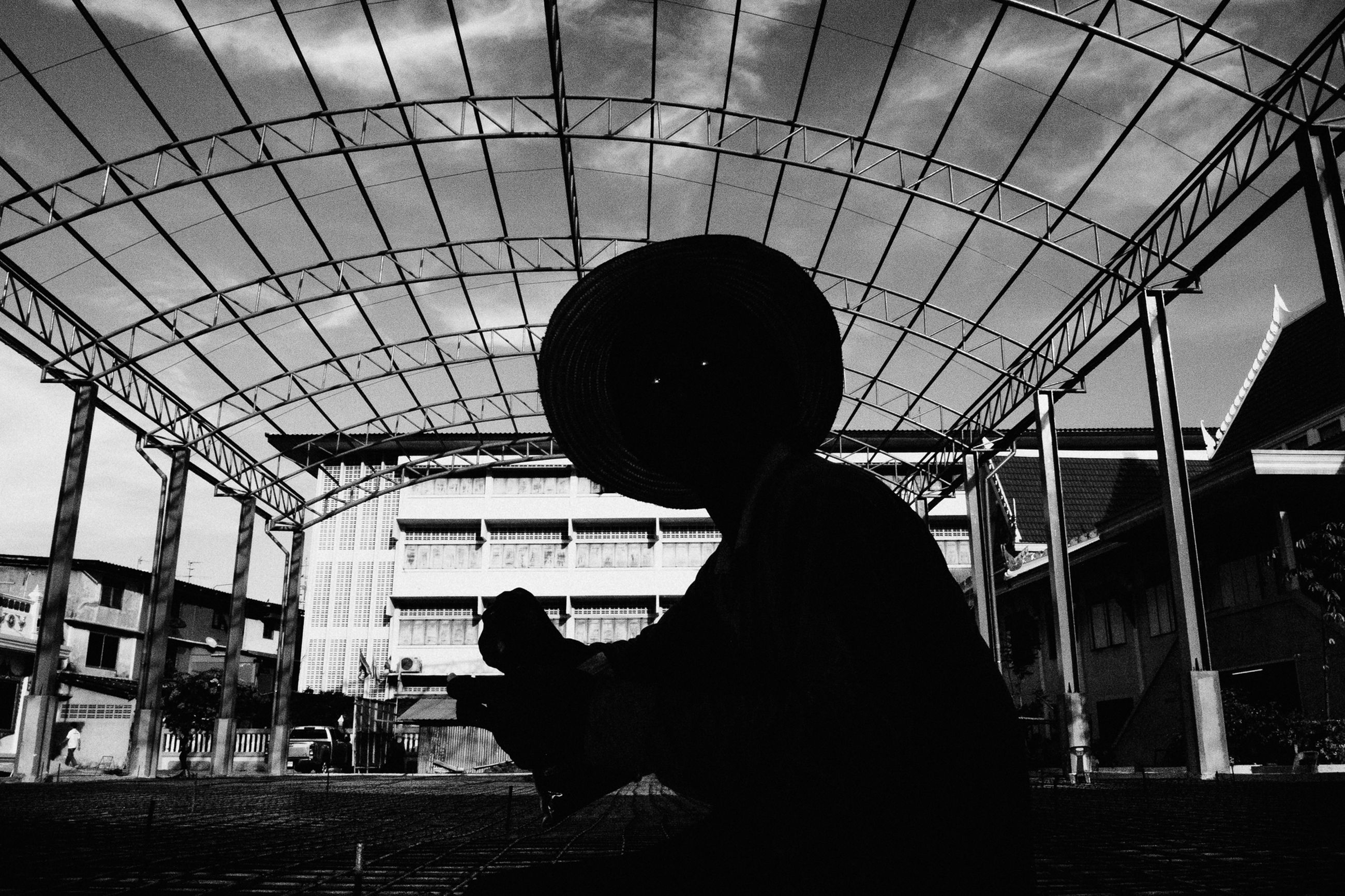 indoors, men, built structure, architecture, silhouette, city, day, sky, in front of