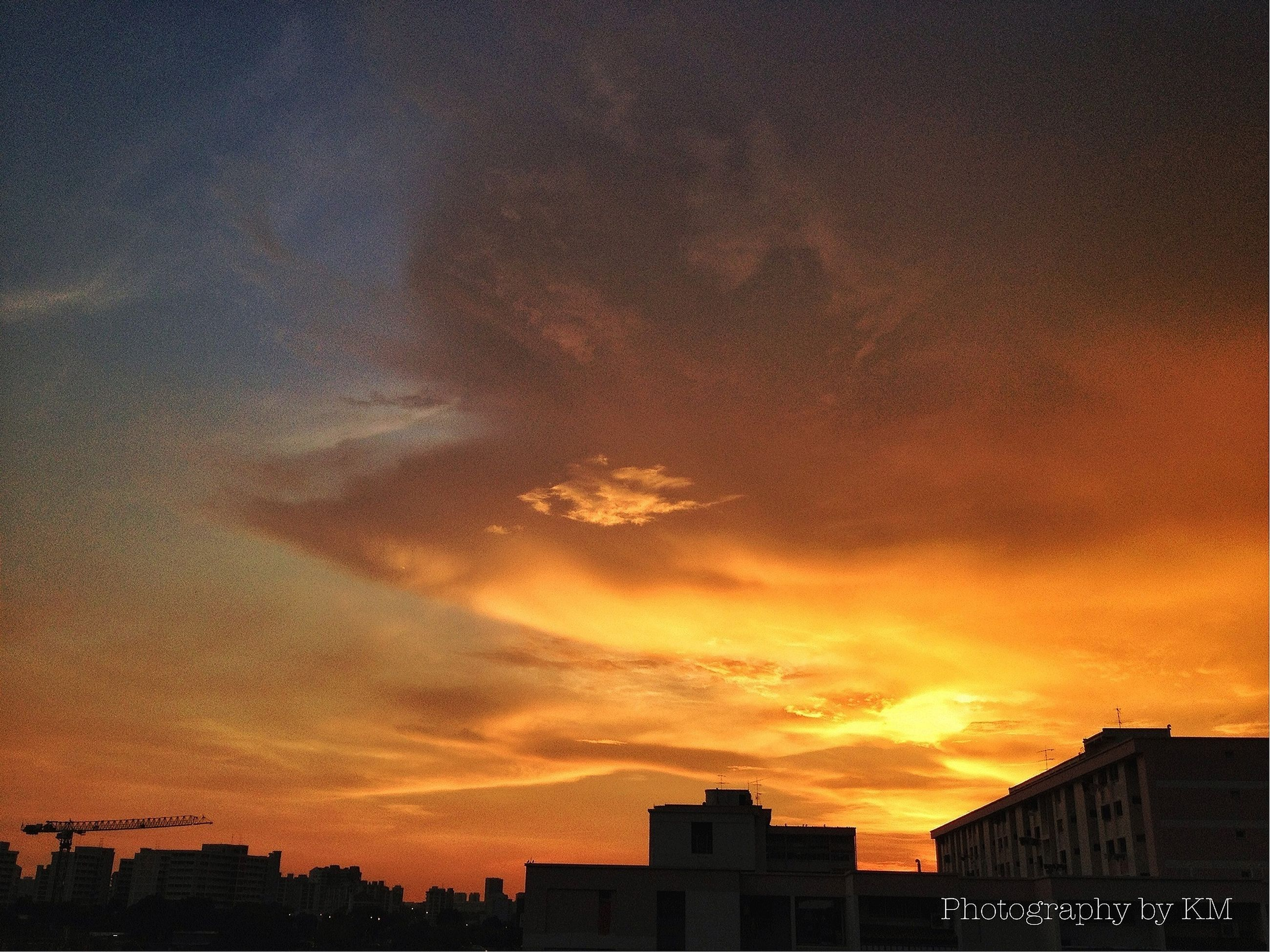 building exterior, sunset, architecture, built structure, orange color, sky, cloud - sky, silhouette, low angle view, city, residential structure, residential building, house, building, cloud, dramatic sky, cloudy, outdoors, high section, nature