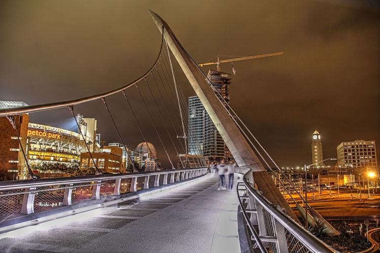 Illuminated bridge and buildings at night