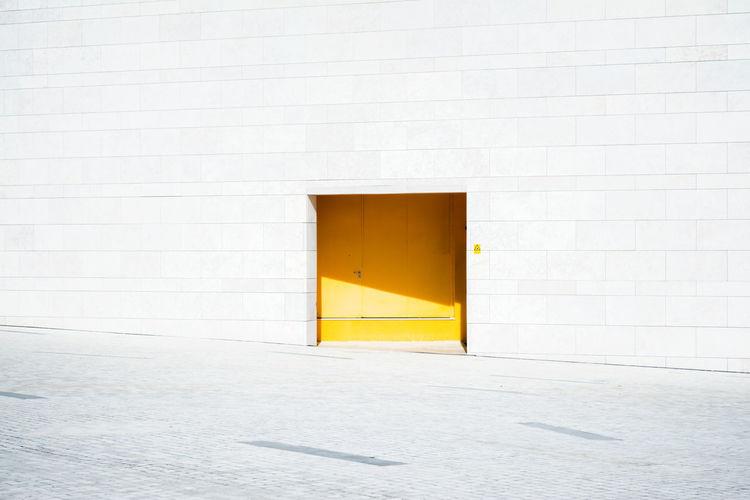 Closed yellow door of building