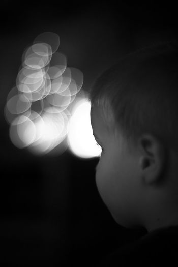 Black & White Black And White Bokeh Boy Child Childhood Children Christmas Lights Contemplative Cute Depth Of Field Face Human Body Part Indoors  Innocence Lifestyles Lights Pensive Person Real People Reasonable Selective Focus Thoughtful