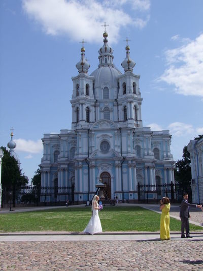 Wedding photograph Architecture Blue And White Blue Sky White Clouds Built Structure Church Colors Dome Façade Famous Place Full Frame Grass Incidental People Lawn Leisure Activity Lifestyles Outdoor Photography Religion Russia Saint Petersburg Tourism Tranquil Travel Destinations Two Towers Wedding Dress Wedding Photography