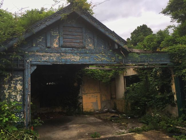 Abandoned Abandoned Buildings Blue Cracked Paint Garage ShotoniPhone6s London Derelict Nature On Your Doorstep Nature Vs City