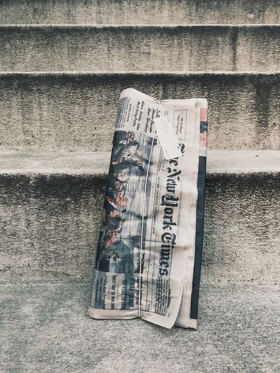 Newspaper New York Times No People Built Structure Wall - Building Feature Architecture Day Communication Sunlight Building Exterior Text Textured  Paper Outdoors Wall Script Nature Close-up Pattern High Angle View Non-western Script Shadow