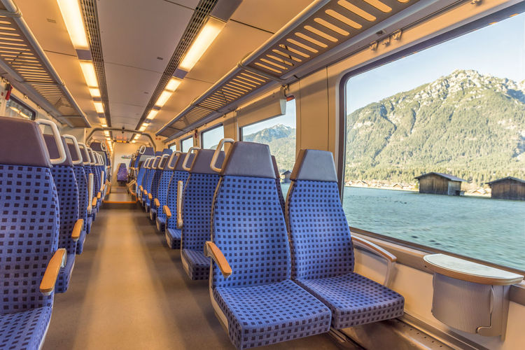 Interior of empty train against river