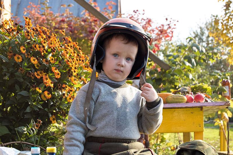 Portrait of cute boy against plants