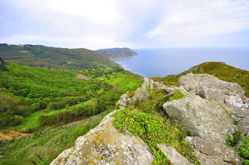 coast of death in galicia spain SPAIN Coast Of Death Galicia Spain Beauty In Nature Cloud - Sky Coast Of Death In Galicia Spain Day Grass Green Color Landscape Mountain Nature No People Outdoors Rock - Object Scenics Sea Sky Tranquil Scene Tranquility Water