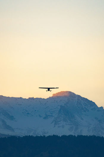 Colorado Boulder Nature Air Vehicle Sky Flying Mode Of Transportation Airplane Transportation Mid-air Beauty In Nature Scenics - Nature Mountain Copy Space Sunset Clear Sky No People Travel Low Angle View Motion Silhouette Outdoors Aerospace Industry Plane