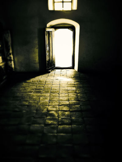 The Light at the end of ... Arch Architecture Backlit Built Structure Corridor Day Door Empty Flooring Indoors  Light At The End Of Tunnel Narrow Paving Stone The Way Forward First Eyeem Photo The Week On EyeEm