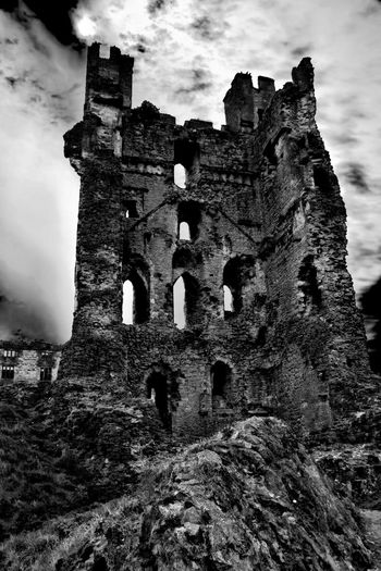 Low angle view of abandoned castle against sky