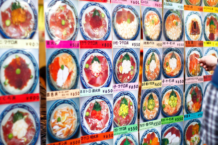 In front of a restaurant that shows picture of the food tourist will order Arrangement Choice Cuisine Culture Detail Food Healthy Healthy Food Japa Japan Japanese  Japanese Culture Japanese Food Japanese Style Large Group Of Objects Order Picture Rice Seafood Selection Travel
