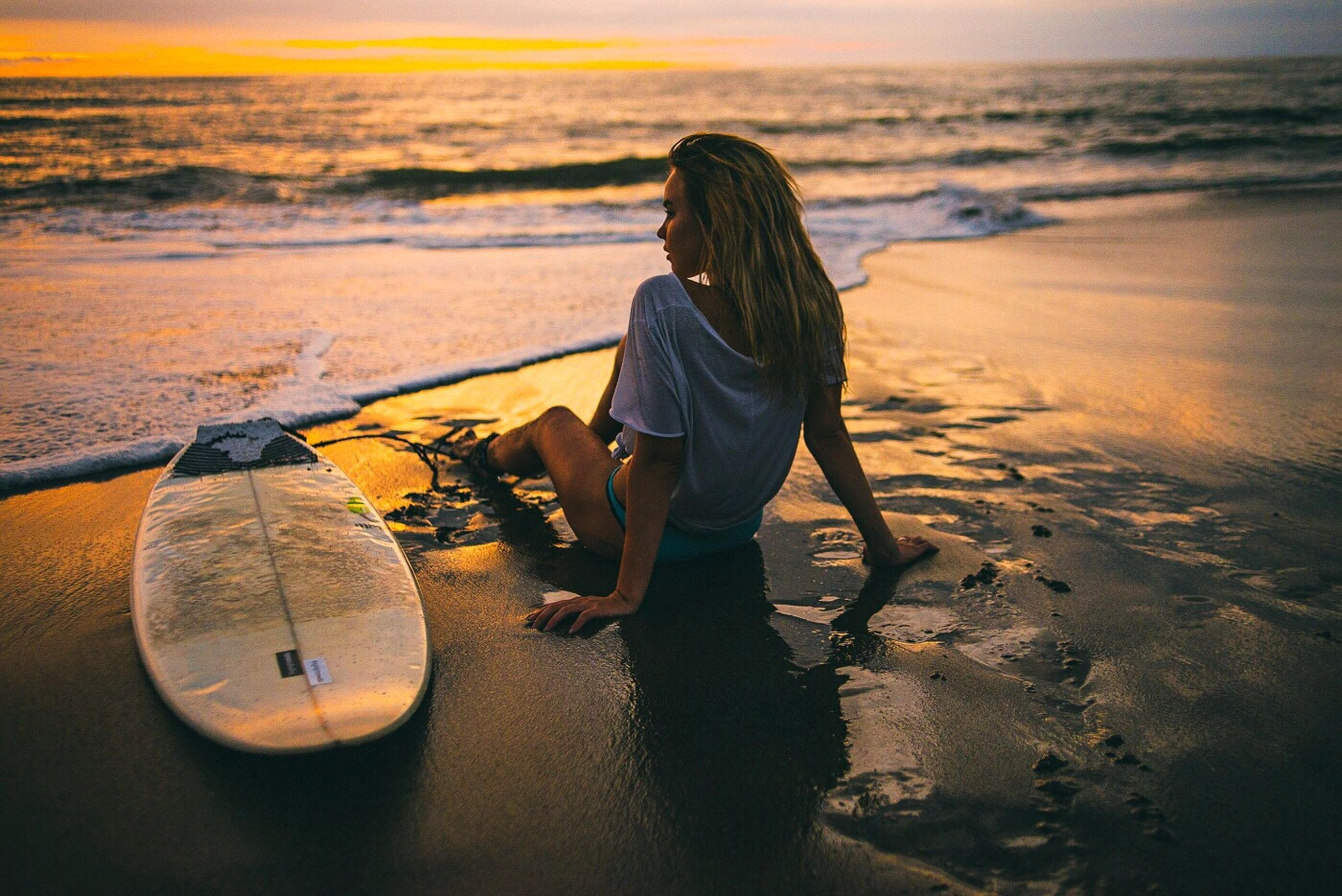 beach, sea, one person, full length, sunset, shore, water, real people, sand, lifestyles, nature, leisure activity, horizon over water, outdoors, women, scenics, standing, beauty in nature, young adult, sky, young women, day, adult, adults only, people