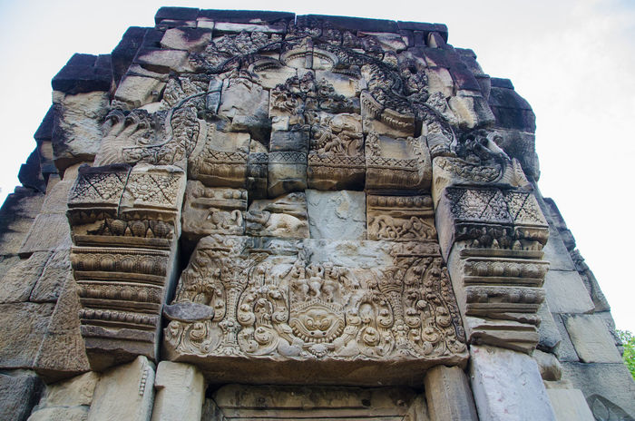 Ancient Architecture Art And Craft Building Exterior Built Structure Castle Day Famous Place History Low Angle View Old Old Ruin Outdoors Place Of Worship Religion Sky Spirituality Stone Material Stone Wall Thailand The Past Tympanum Weathered Prasat Ban Phluang Baphuon