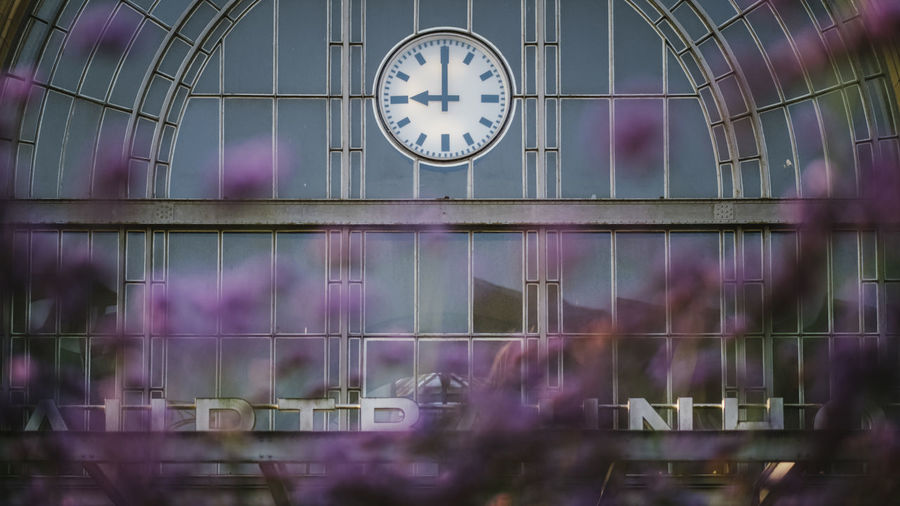 Low angle view of clock on glass window