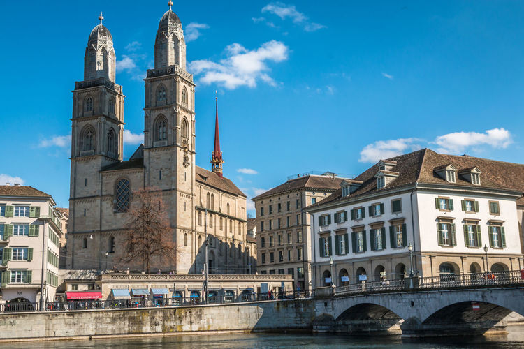 The Grossmunster of Zurich Zürich Zurich, Switzerland Grossmünster Grossmünster Zürich Built Structure Architecture Building Exterior Sky Building Bridge Bridge - Man Made Structure City Water Connection Nature Cloud - Sky Travel Destinations Travel Place Of Worship Religion Transportation Tourism Arch No People Outdoors Canal Arch Bridge
