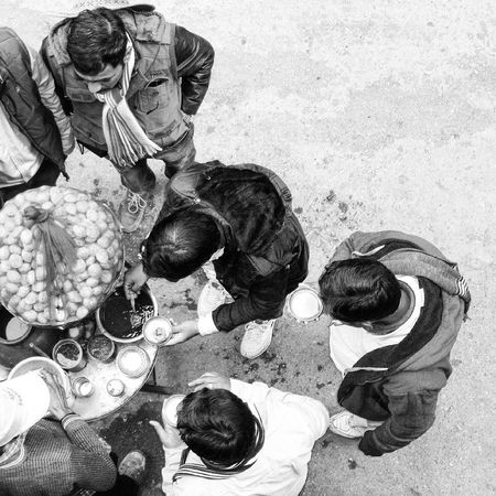 Black And White Culture Daily Life EyeEm EyeEm Best Edits EyeEm Best Shots EyeEm Gallery EyeEmBestPics Friends Going Unnoticed Ground Group Of People Indian Culture  Indian Food Outdoors Street Food Street Photography Street Vendor The Street Photographer - 2016 EyeEm Awards View From Above