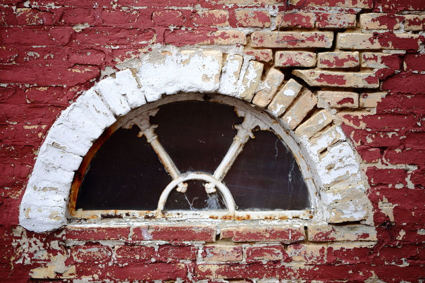 Architectural Detail Architecture Beauty Of Decay Brick Wall Chipping Paint Circle Closed Erosion Eye4photography  EyeEm Best Shots Live For The Story Flaking Paint Hello World House Mysterious Old Ornaments Paint Red And White Shabby Spalling The Architect - 2017 EyeEm Awards Traditional Wall Window