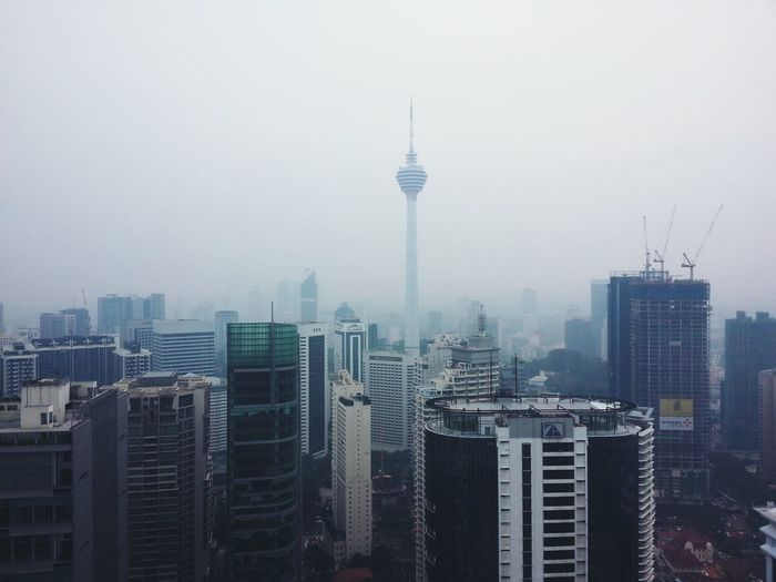 View of cityscape during foggy weather
