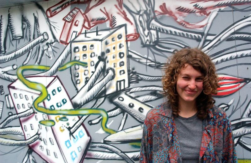Portrait Of Woman Standing Against Graffiti Wall