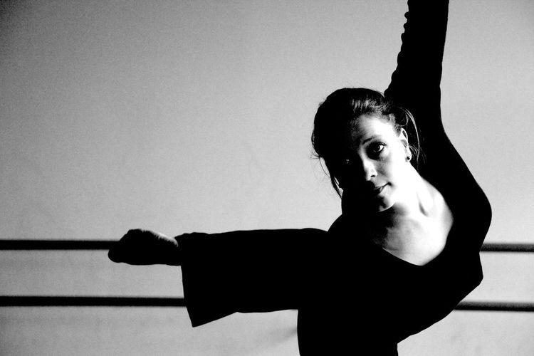 Confident woman dancing in studio
