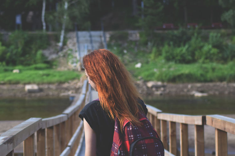 Day Focus On Foreground Leisure Activity Lifestyles Long Hair Nature One Person Outdoors Railing Real People Rear View Redhead Standing Water Young Adult Young Women Lost In The Landscape
