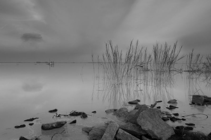 Water Sky Tranquility Beauty In Nature Rock Tranquil Scene Scenics - Nature Solid Rock - Object Cloud - Sky Nature Non-urban Scene Sea No People Idyllic Beach Reflection Blackandwhite Black And White Black & White Blackandwhite Photography Long Exposure Longexposurephotography