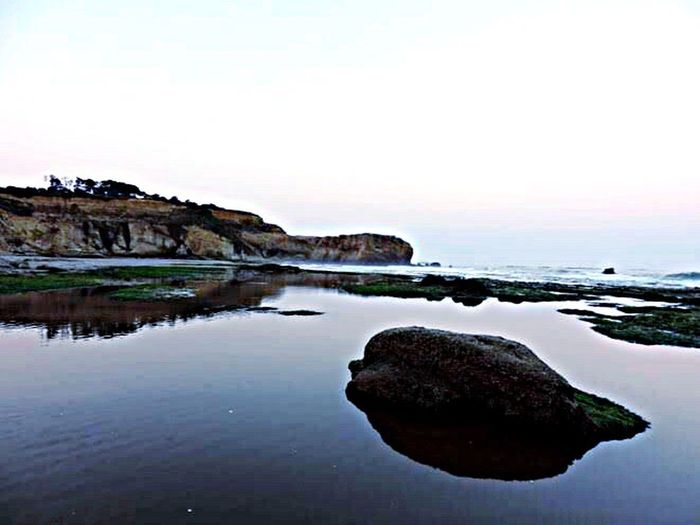 Water Rock - Object Tranquil Scene Nature Tranquility Reflection Outdoors Depoe Bay, OR Beauty In Nature Scenics Sea Sky Day Clear Sky Horizon Over Water