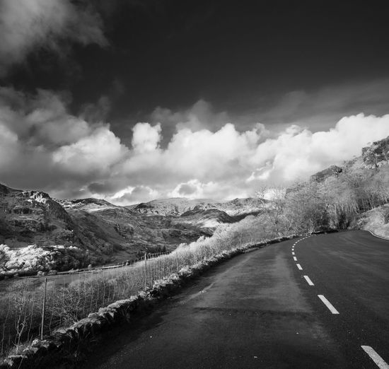 The road from Beddgelert to Capel Curig, North Wales. Blackandwhite Cloud Cloud - Sky Cloudscape Cloudy Dramatic Sky Horizon Over Land Landscape Leading Majestic Monochrome Mountain Outdoors Perspective Remote Road Scenics Sky The Way Forward Tranquil Scene Tranquility Weather