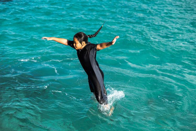 Girl diving in sea