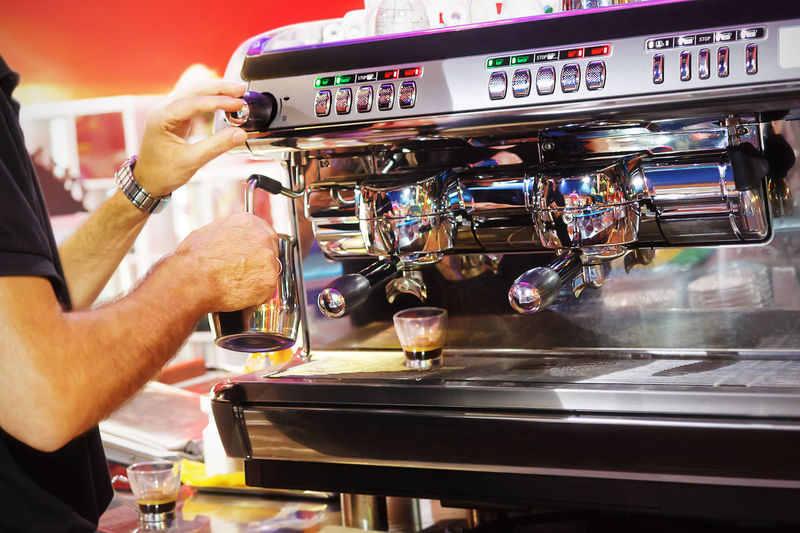 Barman prepares hot milk and espresso, for customers of the bar. Modern Workplace Culture Barman Cafe Close-up Coffee - Drink Coffee Cup Drink Espresso Maker Food And Drink Freshness Holding Human Body Part Human Hand Indoors  Machinery Making Men Occupation One Man Only One Person Preparation  Real People Skill  Working