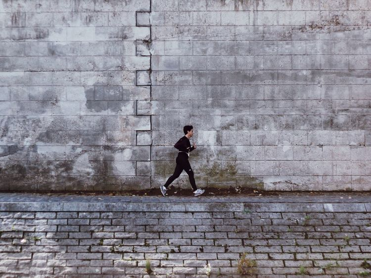 Miles Away Paris Run Running Brick Wall City Full Length Outdoors Lifestyles One Person Built Structure Leisure Activity Day Real People Architecture Young Adult People Adult Streetphotography Street Photography מייפריס Women Around The World Break The Mold TCPM