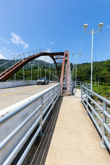 Bridge over street against sky