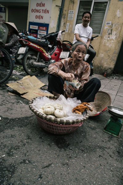 Sales woman in Ha Noi, Vietnam Architecture ASIA Day Eralymorning Food Food And Drink Freshness Hanoi Hanoi Vietnam  Mammal Market Men Oldlady One Person Outdoors People Real People Saleswoman Sitting Streetart Streetphotography Vietnam Vietnamese Woman Woman Portrait