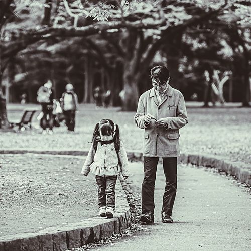 """""""Walking in the park"""" Walking Family Family With One Child Real People Daughter Love Childhood Full Length Togetherness Day Father Adult Child Bonding Outdoors Men Lifestyles Tokyo Streetphotography EyeEm Selects City Life Tokyo City Street EyeEm Gallery Japan This Is Family"""