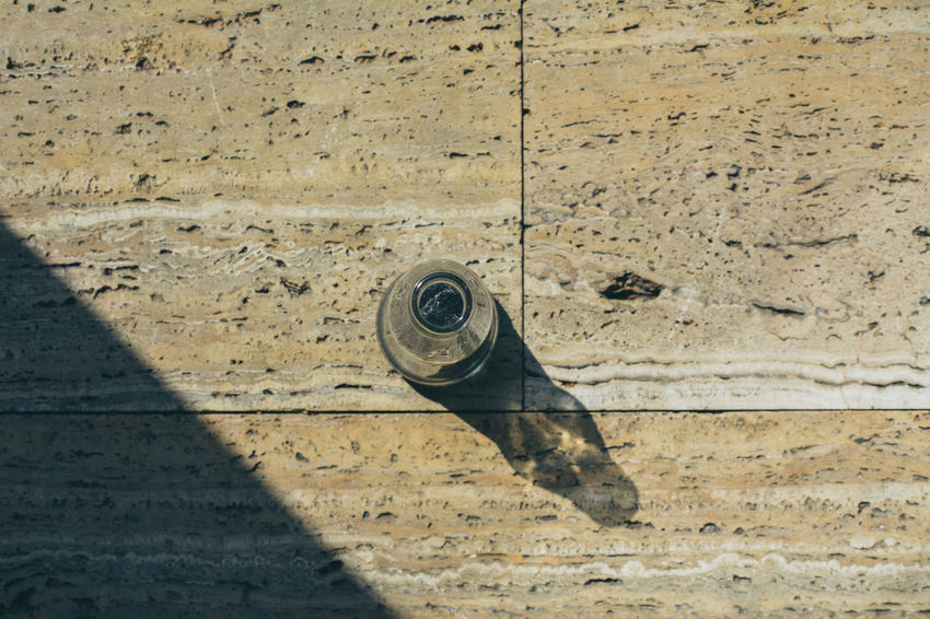 Bottle EyeEm EyeEm Best Shots High Angle View No People Popular Photo Popular Photos Quality Reflection Shadow Shadow Drop Shadows & Lights Simple Photography Stone Straight Lines Sunlight Sunlight The Weekend On EyeEm Unique Perspectives View From Above VSCO
