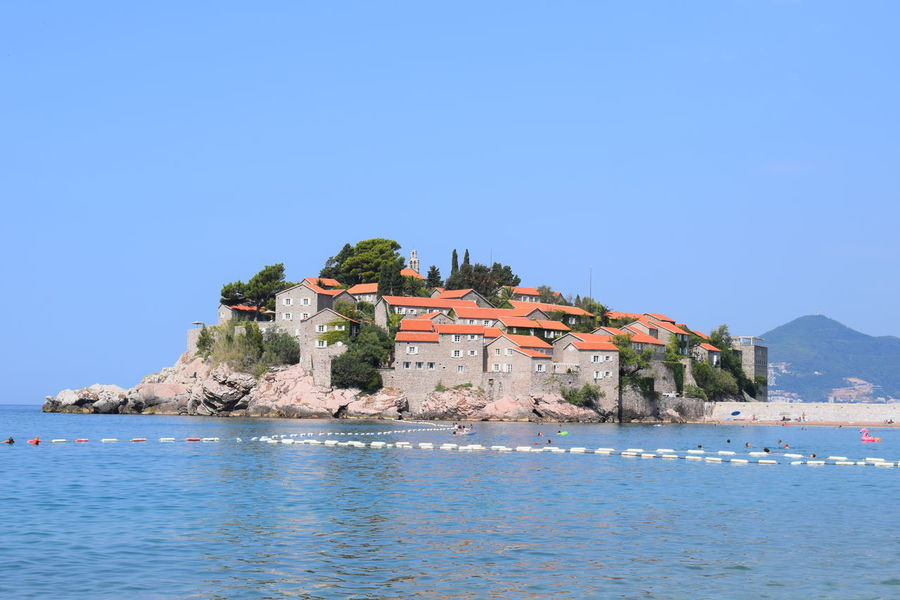 SvetiStefan Architecture Beauty In Nature Blue Building Building Exterior Built Structure Clear Sky Copy Space Day Land Montenegro Mountain Nature No People Outdoors Scenics - Nature Sea Sky The Past Water Waterfront