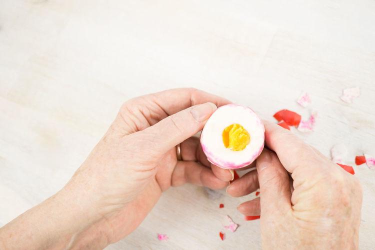 Easter Egg Eating Hands Caucasian Eating Healthy Egg Food Healthy Human Body Part Peel Peel An Egg People Senior Senior Adult Shell Yolk