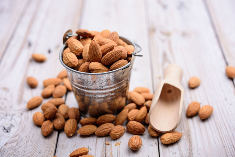 Food And Drink Food Nut - Food Nut Still Life Freshness Table Brown Indoors  Large Group Of Objects Wood - Material Almond Close-up Healthy Eating No People Selective Focus Wellbeing Bowl Focus On Foreground Walnut Snack