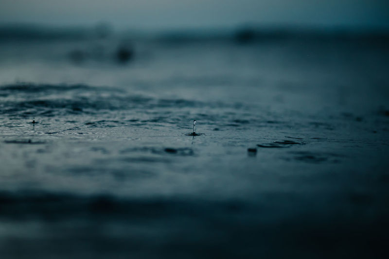 Surface Level Of Sea During Rainfall At Dusk