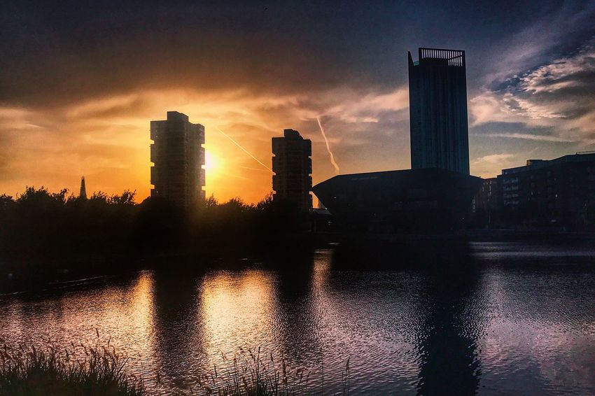 Sunset Architecture Built Structure Building Exterior Reflection Sky Skyscraper Water Waterfront Cloud - Sky Modern River No People City Travel Destinations Silhouette Urban Skyline Nature Outdoors Beauty In Nature The Week On EyeEm