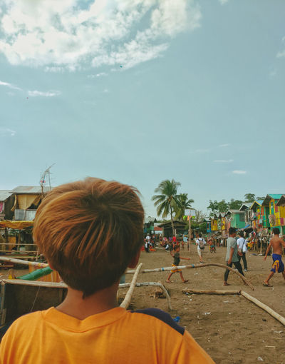 From the perspective of the Badjao child. A scene from the Badjao Community at Davao City. Tribe Badjao Davao Philippines EyeEm Best Shots Streetphotography Street Photography Street Scene Eyeem Philippines Sea Denizen Badjao Village Sea Gypseas Child City Rear View Sky Civilization The Mobile Photographer - 2019 EyeEm Awards The Street Photographer - 2019 EyeEm Awards The Photojournalist - 2019 EyeEm Awards My Best Photo