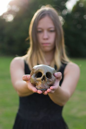 Life and Death... Real People Holding Front View Focus On Foreground Outdoors Women One Person Human Hand Close-up Lifestyles Day Nature People Portrait Detail Moody Tones Photography Depth Of Field Light And Shadow Check This Out Colorful Skull Life EyeEm Selects