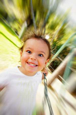 A goofy girl is swinging. Back To Childhood  Childhood Comical Crazy Face Crazy Hair Crazy Kid Crazy Smile EyEmNewHere Face Expression Goofy Goofyface Happiness Kid Smiling Kidsphotography Life In Motion Look At Me Memories Motion Photography Playing In The Nature Silly Face Silly Faces  Silly Girl Smiling Face Swinging Swinging Motion The Portraitist - 2017 EyeEm Awards