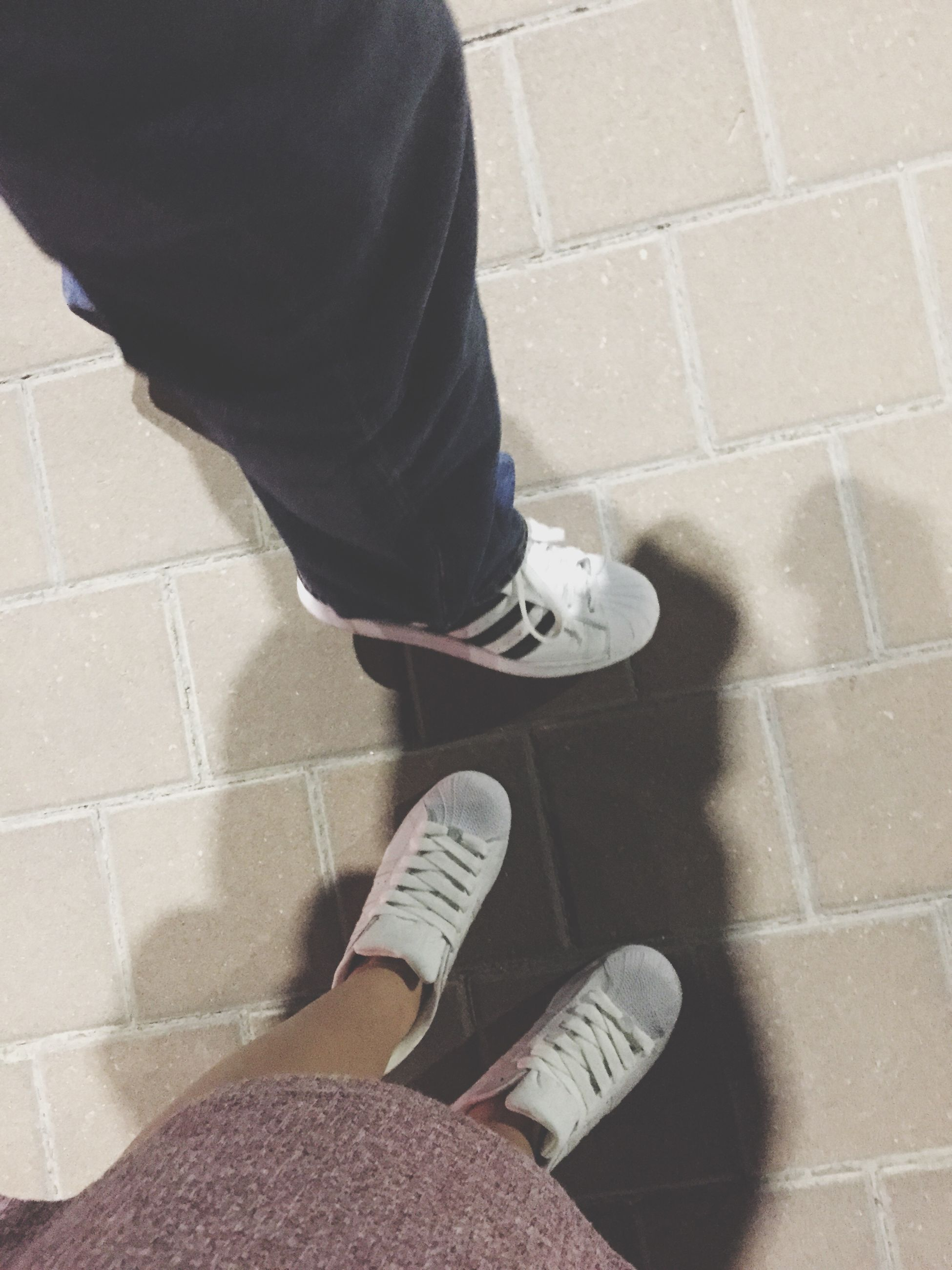 low section, person, shoe, lifestyles, standing, men, casual clothing, high angle view, leisure activity, personal perspective, human foot, jeans, tiled floor, footwear, flooring, indoors