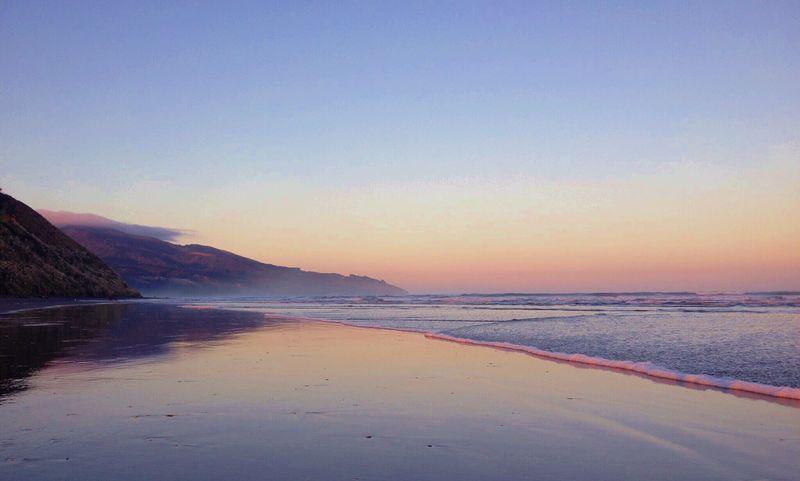 Glow of a new day Raglan Nz Sunrise Beach IPhoneography Creative Light And Shadow Summer Views Summer Summertime New Zealand