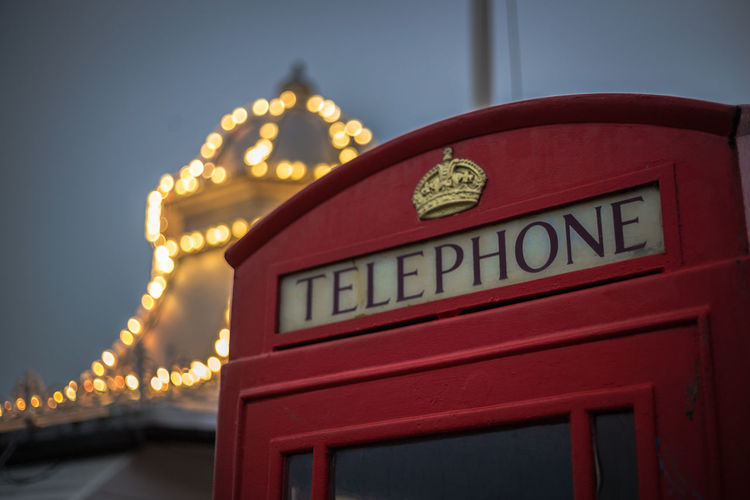Text Communication Illuminated Architecture Western Script Telephone Built Structure Telephone Booth Building Exterior No People Capital Letter City Connection Technology Focus On Foreground Dusk Red Sky Clock Iconic Brighton Brett Kotch Bokeh British Selective Focus