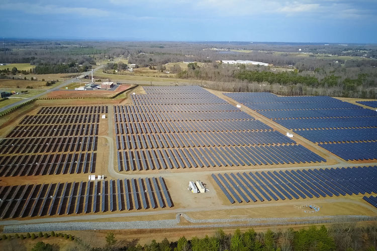 solar panels Environment Sky Landscape Nature Solar Energy Renewable Energy Solar Panel Day Alternative Energy Architecture High Angle View Cloud - Sky Environmental Conservation Horizon Field Land Aerial View Technology Fuel And Power Generation Outdoors No People Sustainable Resources Solar Panels